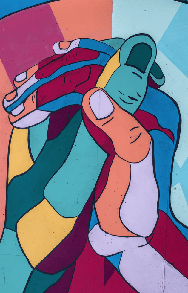 Colorful cartoon hands holding tightly